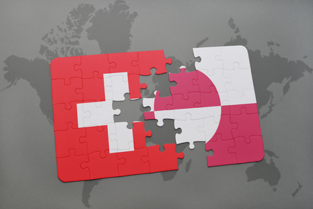 danish flag: puzzle with the national flag of switzerland and greenland on a world map background. 3D illustration Stock Photo