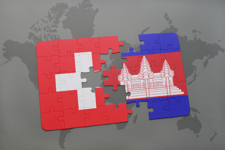 cambodian: puzzle with the national flag of switzerland and cambodia on a world map background. 3D illustration