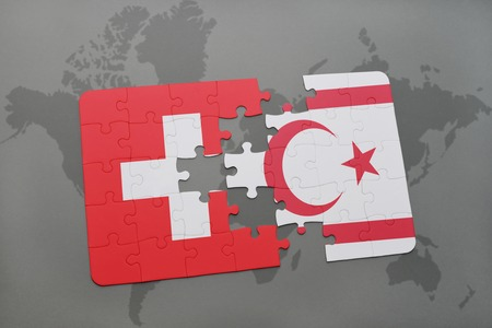 puzzle with the national flag of switzerland and northern cyprus on a world map background. 3D illustration Stock Photo