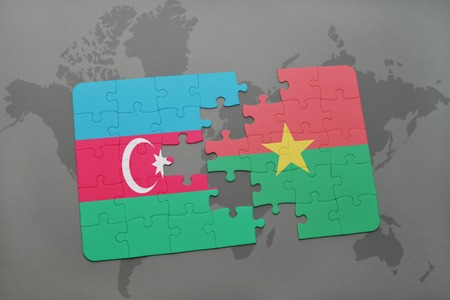 puzzle with the national flag of azerbaijan and burkina faso on a world map background. 3D illustration