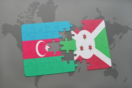 puzzle with the national flag of azerbaijan and burundi on a world map background. 3D illustration Stock Photo