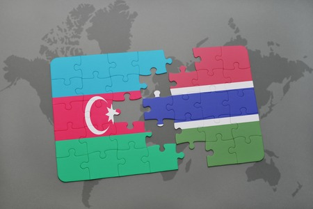 baku: puzzle with the national flag of azerbaijan and gambia on a world map background. 3D illustration
