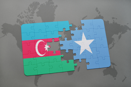 puzzle with the national flag of azerbaijan and somalia on a world map background. 3D illustration