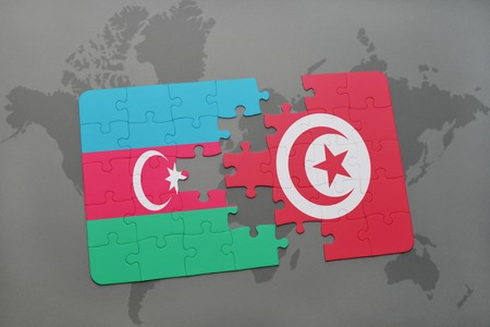 puzzle with the national flag of azerbaijan and tunisia on a world map background. 3D illustration
