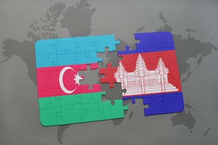 cambodian: puzzle with the national flag of azerbaijan and cambodia on a world map background. 3D illustration