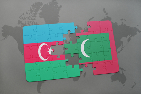 puzzle with the national flag of azerbaijan and maldives on a world map background. 3D illustration Stock Photo