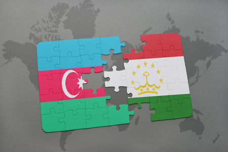 puzzle with the national flag of azerbaijan and tajikistan on a world map background. 3D illustration