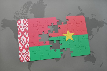 puzzle with the national flag of belarus and burkina faso on a world map background. 3D illustration