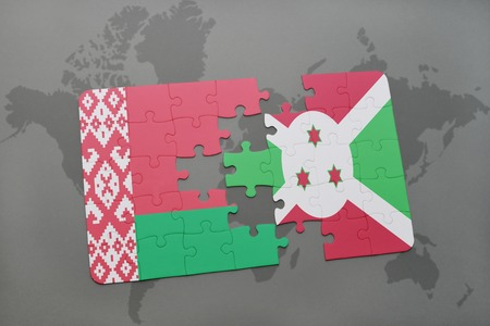 puzzle with the national flag of belarus and burundi on a world map background. 3D illustration