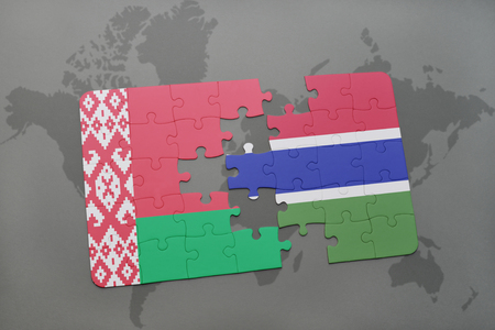 puzzle with the national flag of belarus and gambia on a world map background. 3D illustration