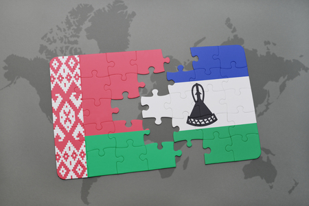 lesotho: puzzle with the national flag of belarus and lesotho on a world map background. 3D illustration Stock Photo