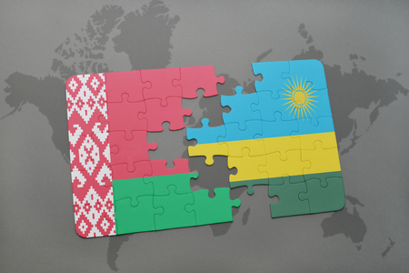 kigali: puzzle with the national flag of belarus and rwanda on a world map background. 3D illustration Stock Photo