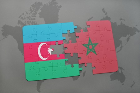 puzzle with the national flag of azerbaijan and morocco on a world map background. 3D illustration