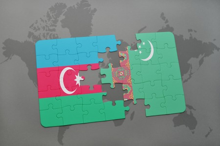 puzzle with the national flag of azerbaijan and turkmenistan on a world map background. 3D illustration Stock Photo