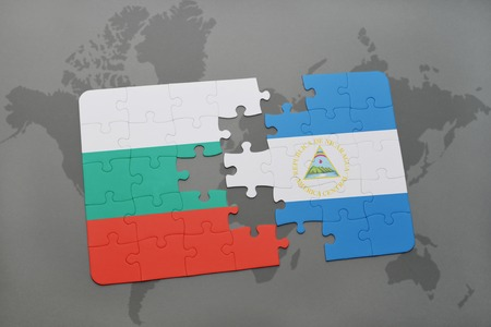 bulgarian: puzzle with the national flag of bulgaria and nicaragua on a world map background. 3D illustration Stock Photo