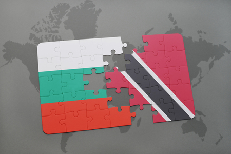 bulgarian: puzzle with the national flag of bulgaria and trinidad and tobago on a world map background. 3D illustration Stock Photo