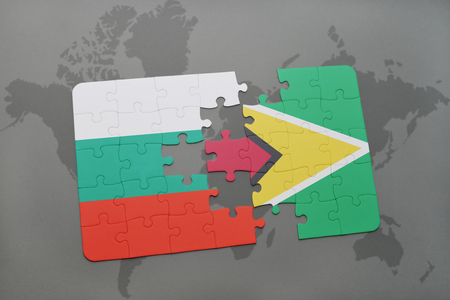 guyanese: puzzle with the national flag of bulgaria and guyana on a world map background. 3D illustration Stock Photo
