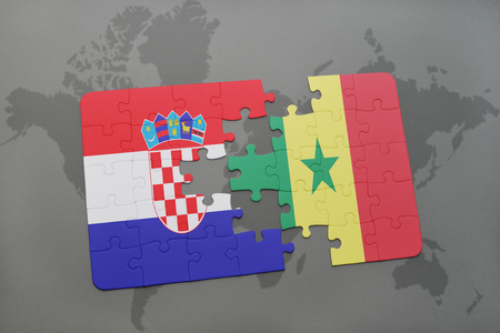 dakar: puzzle with the national flag of croatia and senegal on a world map background. 3D illustration Stock Photo