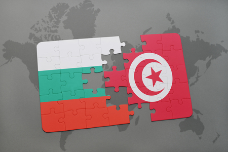 bulgarian: puzzle with the national flag of bulgaria and tunisia on a world map background. 3D illustration