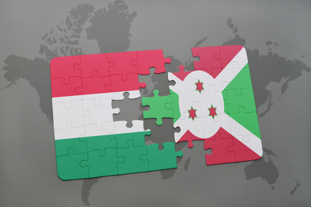 puzzle with the national flag of hungary and burundi on a world map background. 3D illustration