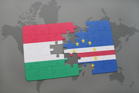 praia: puzzle with the national flag of hungary and cape verde on a world map background. 3D illustration