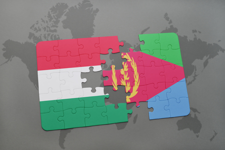 eritrea: puzzle with the national flag of hungary and eritrea on a world map background. 3D illustration
