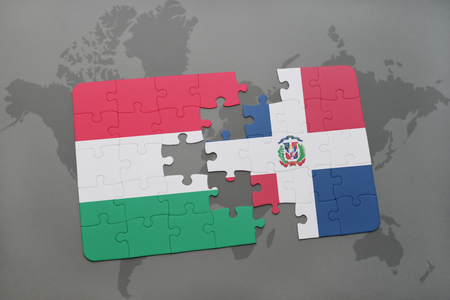 domingo: puzzle with the national flag of hungary and dominican republic on a world map background. 3D illustration