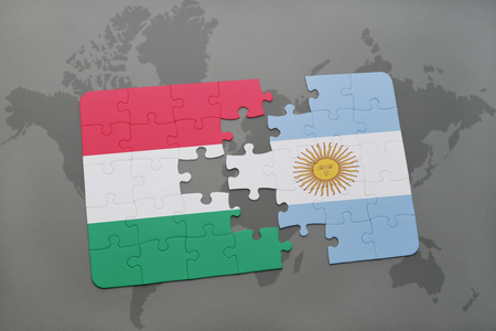 aires: puzzle with the national flag of hungary and argentina on a world map background. 3D illustration Stock Photo
