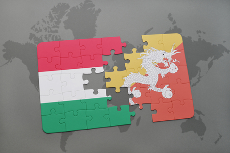 bhutan: puzzle with the national flag of hungary and bhutan on a world map background. 3D illustration Stock Photo