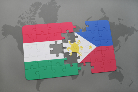 puzzle with the national flag of hungary and philippines on a world map background. 3D illustration Stock Photo
