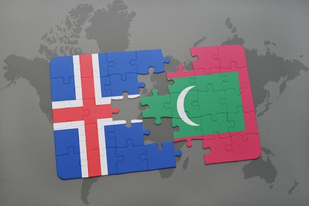 the icelandic flag: puzzle with the national flag of iceland and maldives on a world map background. 3D illustration Stock Photo