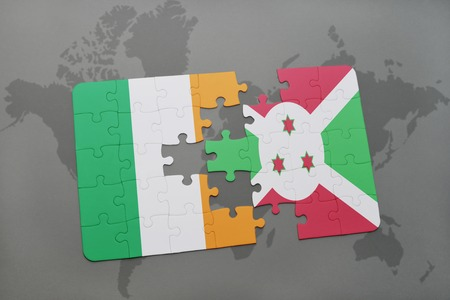 irish map: puzzle with the national flag of ireland and burundi on a world map background. 3D illustration