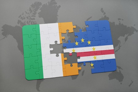 praia: puzzle with the national flag of ireland and cape verde on a world map background. 3D illustration Stock Photo
