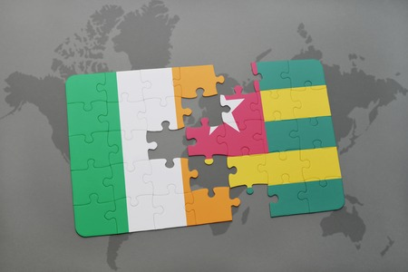 irish map: puzzle with the national flag of ireland and togo on a world map background. 3D illustration Stock Photo