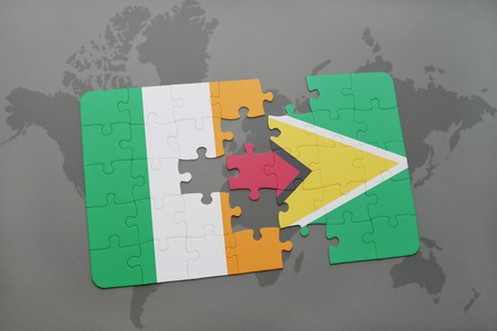 guyanese: puzzle with the national flag of ireland and guyana on a world map background. 3D illustration Stock Photo