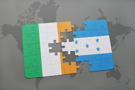 northern ireland: puzzle with the national flag of ireland and honduras on a world map background. 3D illustration