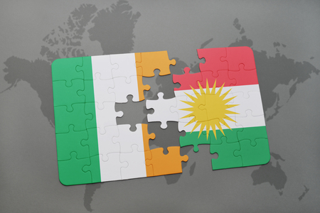 irish map: puzzle with the national flag of ireland and kurdistan on a world map background. 3D illustration Stock Photo