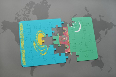 puzzle with the national flag of kazakhstan and turkmenistan on a world map background. 3D illustration