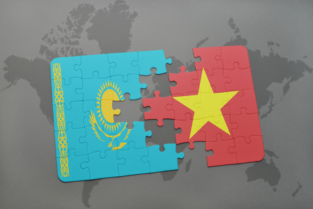 kazakhstan: puzzle with the national flag of kazakhstan and vietnam on a world map background. 3D illustration Stock Photo