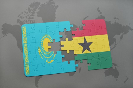 kazakhstan: puzzle with the national flag of kazakhstan and ghana on a world map background. 3D illustration Stock Photo