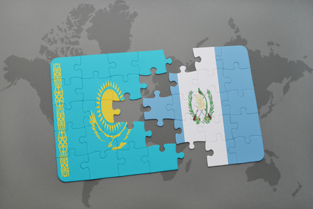 kazakhstan: puzzle with the national flag of kazakhstan and guatemala on a world map background. 3D illustration