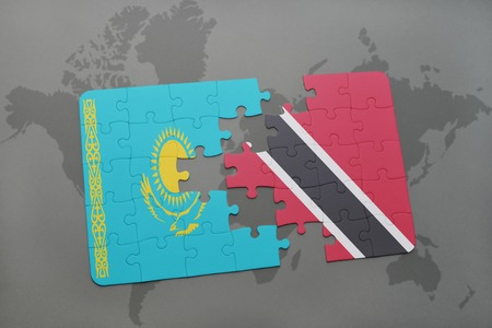 kazakhstan: puzzle with the national flag of kazakhstan and trinidad and tobago on a world map background. 3D illustration