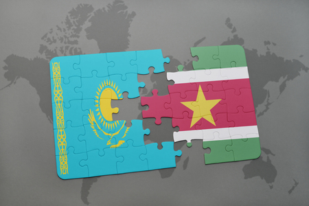 kazakhstan: puzzle with the national flag of kazakhstan and suriname on a world map background. 3D illustration