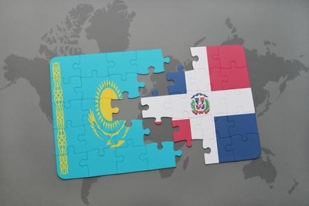 dominican republic: puzzle with the national flag of kazakhstan and dominican republic on a world map background. 3D illustration