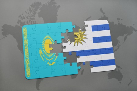 kazakhstan: puzzle with the national flag of kazakhstan and uruguay on a world map background. 3D illustration Stock Photo