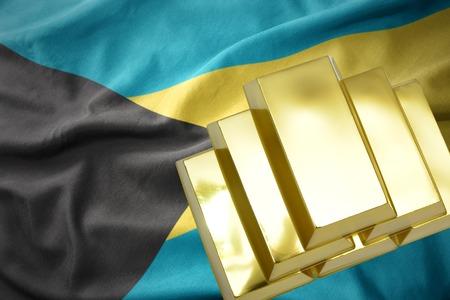gold reserves. shining golden bullions on the bahamas flag background