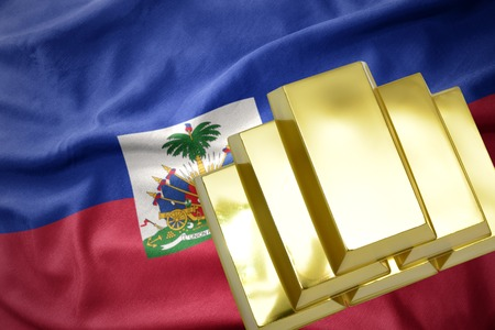 gold reserves. shining golden bullions on the haiti flag background