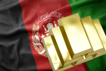 gold reserves. shining golden bullions on the afghanistan flag background