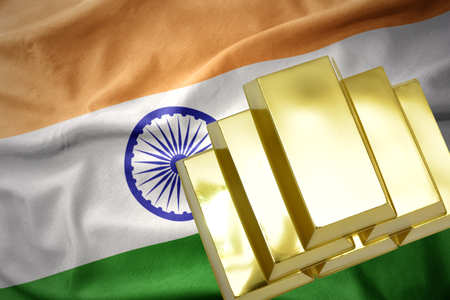 concern: gold reserves. shining golden bullions on the india flag background