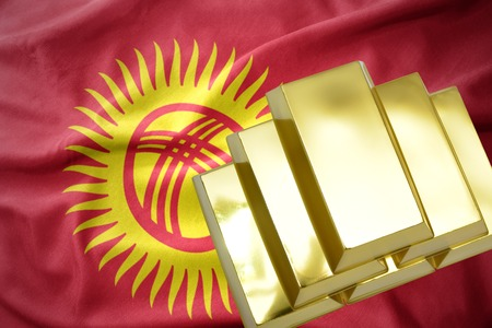 gold reserves. shining golden bullions on the kyrgyzstan flag background